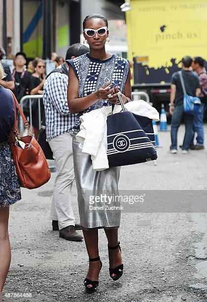 Yomi Abiola is seen outside the Cushnie et Ochs show wearing a vintage outfit with Ferragamo shoes during New York Fashion Week 2016 on September 11...