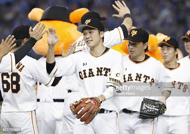 Yomiuri Giants captain Hayato Sakamoto celebrates with teammates after defeating the DeNA BayStars in Tokyo Dome on Oct 9 2016 Sakamoto was named the...