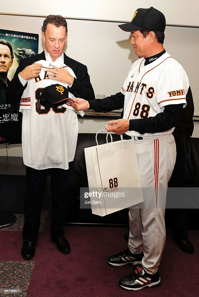 Yomiuri Giants coach Tatsunori Hara and actor Tom Hanks meet press at the reception room during professional baseball match between Yomiuri Giants...