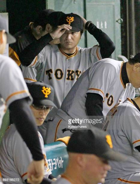 Yomiuri Giants manager Yoshinobu Takahashi leaves the bench after his team lost 85 to the Seibu Lions at MetLife Dome near Tokyo on June 6 2017 The...