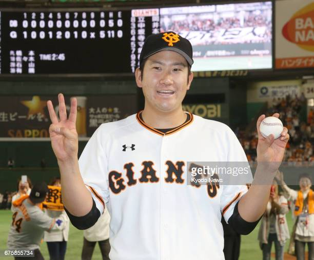 Yomiuri Giants pitcher Tomoyuki Sugano poses for a photo after throwing his third straight completegame shutout in a 50 win over the DeNA BayStars at...