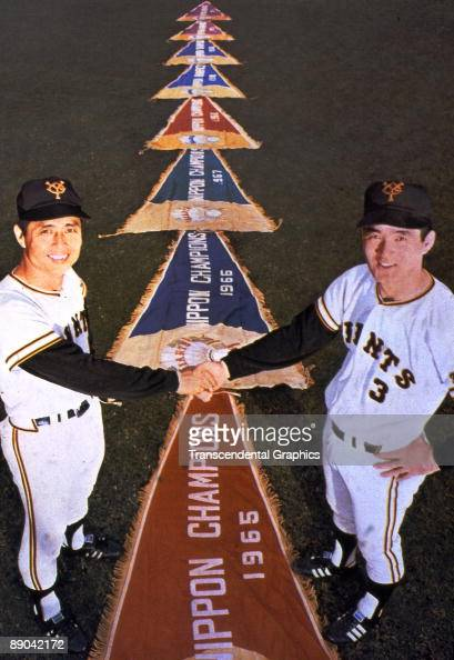 Yomiyuri Giant stars Sadaharun Oh left and Shigeo Nagashima pose with championship pennants during a photo session in Tokyo in 1959