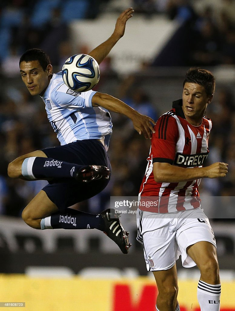 Yonathan Cabral of Racing Club (L) and Guido Carrillo of Estudiantes, fight for the ball during a match between Racing Club and Estudiantes as part of 11th round of Torneo Final 2014 at Presidente Peron Stadium on April 1, 2014 in Buenos Aires, Argentina.