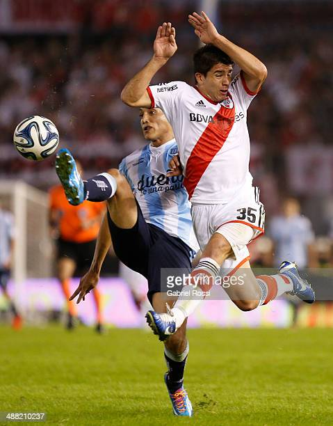 Yonathan Cabral of Racing Club fights for the ball with Giovanni Simeone of River Plate during a match between River Plate and Racing Club as part of...