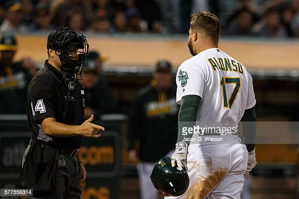 Yonder Alonso of the Oakland Athletics argues a called third strike with umpire Mark Wegner during the fourth inning against the Toronto Blue Jays at...