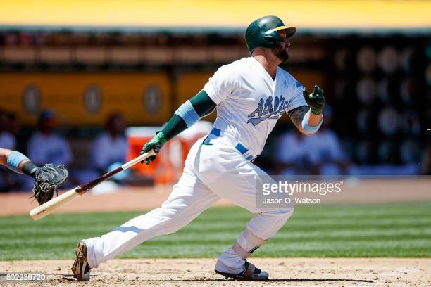 Yonder Alonso of the Oakland Athletics at bat against the New York Yankees during the second inning at the Oakland Coliseum on June 17 2017 in...