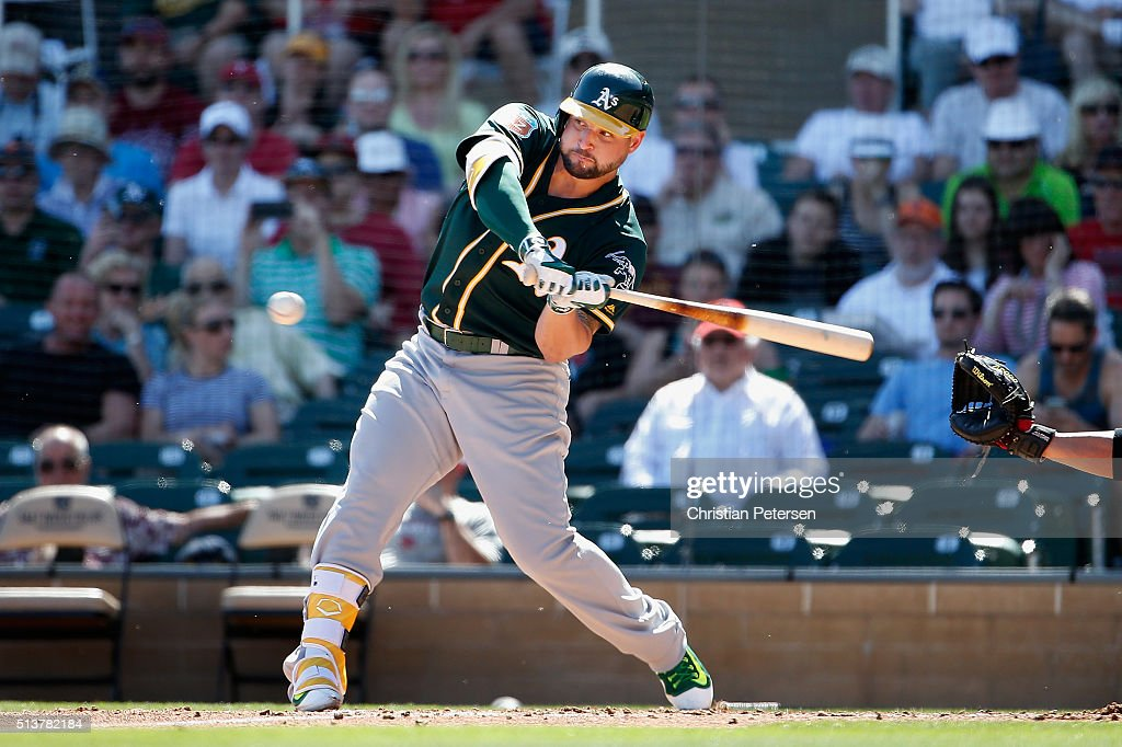 Yonder Alonso of the Oakland Athletics bats against the Arizona Diamondbacks during the second inning of the spring training game at Salt River...