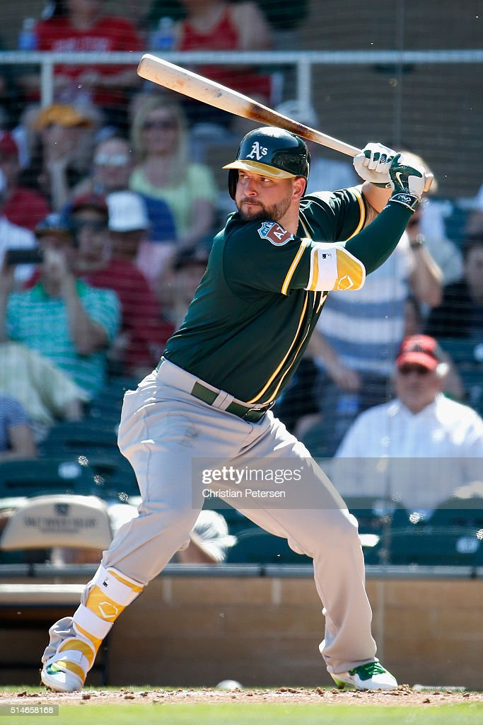 Yonder Alonso of the Oakland Athletics bats against the Arizona Diamondbacks during the spring training game at Salt River Fields at Talking Stick on...