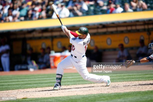 Yonder Alonso of the Oakland Athletics bats during the game against the Atlanta Braves at the Oakland Alameda Coliseum on July 2 2017 in Oakland...