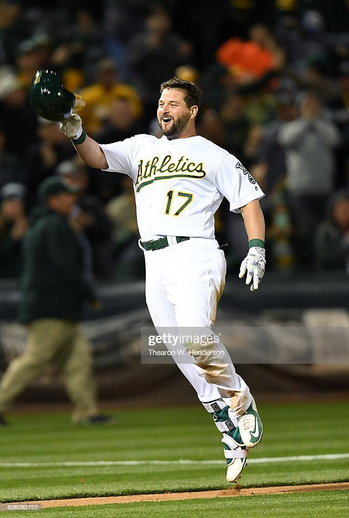 Yonder Alonso of the Oakland Athletics celebrates after he hit a walkoff threerun homer against the Houston Astros in the bottom of the ninth inning...