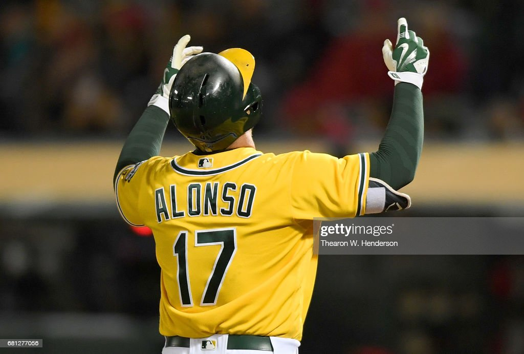 Yonder Alonso #17 of the Oakland Athletics celebrates after hitting a solo home run against the Los Angeles Angels of Anaheim in the bottom of the six inning at Oakland Alameda Coliseum on May 9, 2017 in Oakland, California. The home run was Alonso's second of the game.
