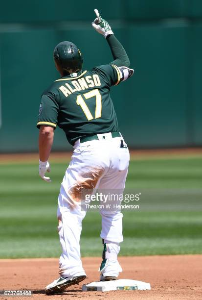 Yonder Alonso of the Oakland Athletics celebrates after hitting an rbi double against the Texas Rangers in the bottom of the first inning at Oakland...