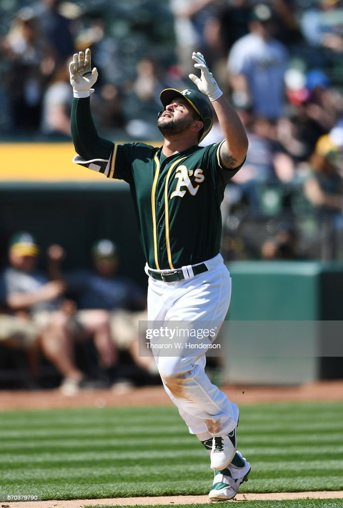 Yonder Alonso #17 of the Oakland Athletics celebrates as he trots around the bases after hitting a solo home run against the Texas Rangers in the bottom of the seventh inning at Oakland Alameda Coliseum on April 19, 2017 in Oakland, California.