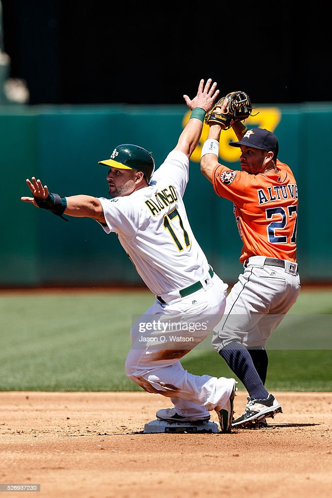 Yonder Alonso #17 of the Oakland Athletics is forced out by Jose Altuve #27 of the Houston Astros at second base during the second inning at the Oakland Coliseum on May 1, 2016 in Oakland, California.
