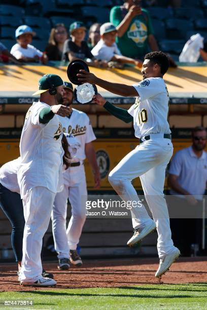 Yonder Alonso of the Oakland Athletics is hit in the face with pie by Marcus Semien after hitting a walk off home run against the Minnesota Twins...