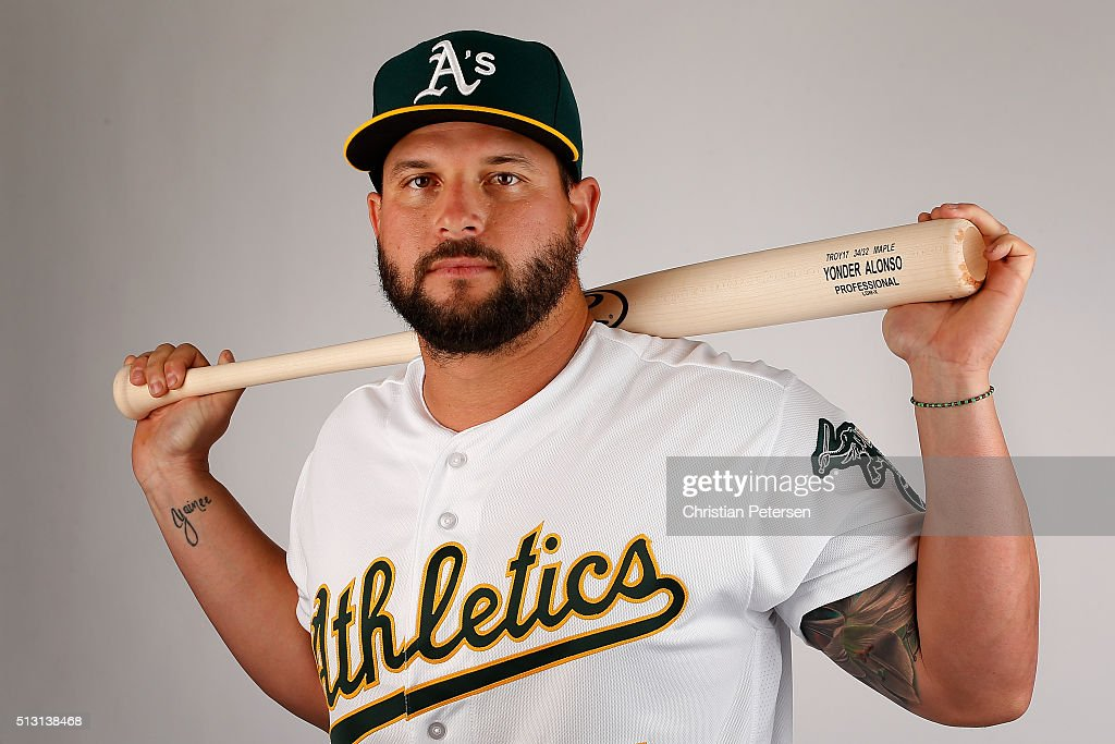 Yonder Alonso of the Oakland Athletics poses for a portrait during the spring training photo day at HoHoKam Stadium on February 29 2016 in Mesa...
