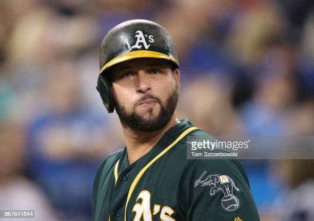 Yonder Alonso of the Oakland Athletics reacts after being called out on strikes in the ninth inning during MLB game action against the Toronto Blue...