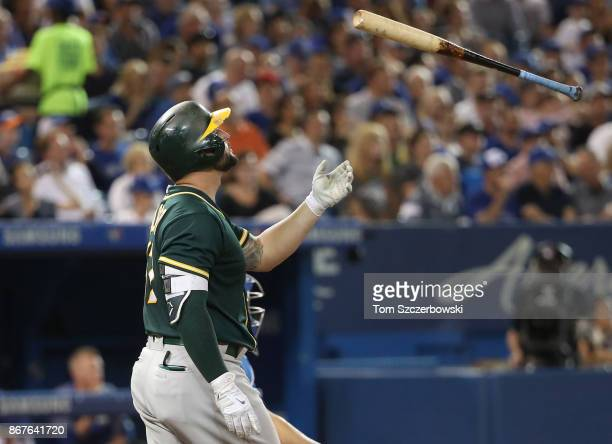 Yonder Alonso of the Oakland Athletics reacts after striking out in the sixth inning during MLB game action against the Toronto Blue Jays at Rogers...