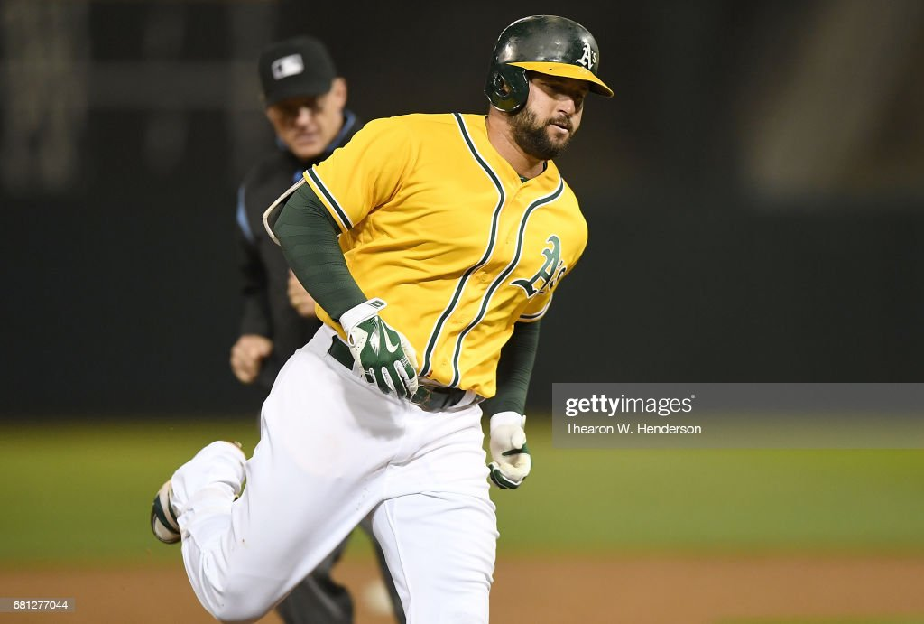 Yonder Alonso #17 of the Oakland Athletics rounds the bases after hitting a solo home run against the Los Angeles Angels of Anaheim in the bottom of the six inning at Oakland Alameda Coliseum on May 9, 2017 in Oakland, California. The home run was Alonso's second of the game.