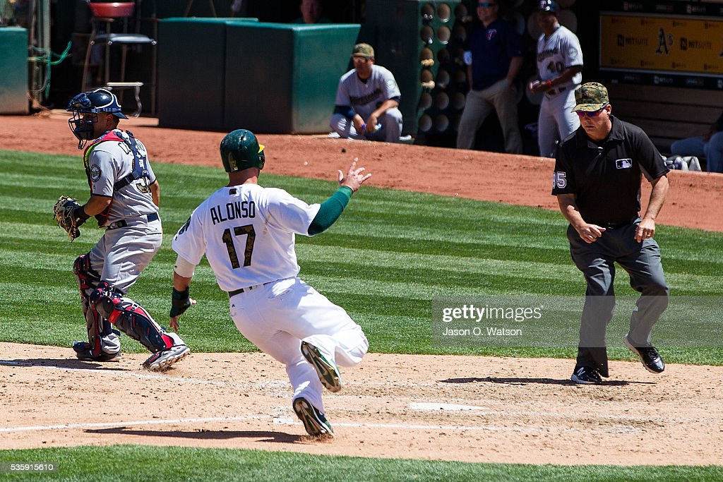 <a gi-track='captionPersonalityLinkClicked' href=/galleries/search?phrase=Yonder+Alonso&family=editorial&specificpeople=4424898 ng-click='$event.stopPropagation()'>Yonder Alonso</a> #17 of the Oakland Athletics scores a run past Juan Centeno #37 of the Minnesota Twins during the fifth inning at the Oakland Coliseum on May 30, 2016 in Oakland, California. The Oakland Athletics defeated the Minnesota Twins 3-2.