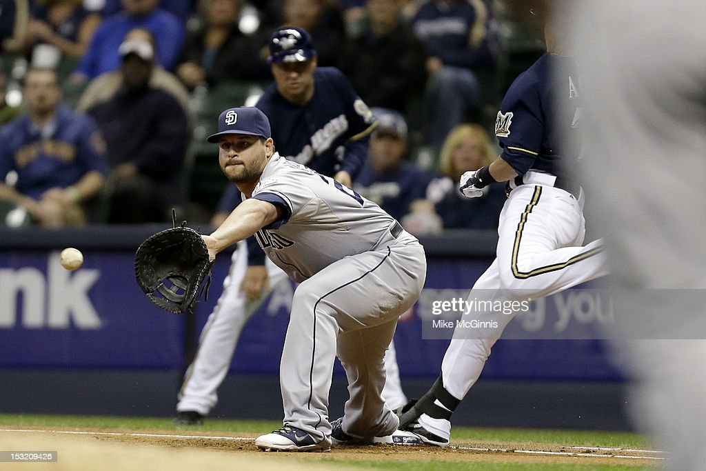 <a gi-track='captionPersonalityLinkClicked' href=/galleries/search?phrase=Yonder+Alonso&family=editorial&specificpeople=4424898 ng-click='$event.stopPropagation()'>Yonder Alonso</a> #23 of the San Diego Padres can't get the throw in time allowing Norichika Aoki #7 of the Milwaukee Brewers in the bottom of the 1st inning at Miller Park on October 1, 2012 in Milwaukee, Wisconsin.
