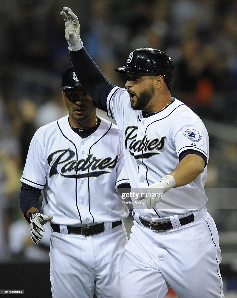 <a gi-track='captionPersonalityLinkClicked' href=/galleries/search?phrase=Yonder+Alonso&family=editorial&specificpeople=4424898 ng-click='$event.stopPropagation()'>Yonder Alonso</a> #23 of the San Diego Padres celebrates after hitting a two-run home run in the fifth inning of a baseball game against the Arizona Diamondbacks at Petco Park on May 3, 2013 in San Diego, California.