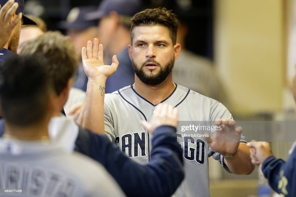 Yonder Alonso of the San Diego Padres celebrates after reach home plate on a RBI single hit by Will Venable in the seventh inning against the...