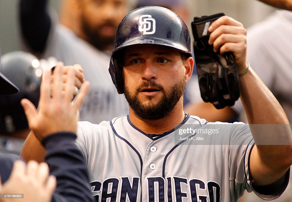 Yonder Alonso of the San Diego Padres celebrates after scoring on a sacrifice fly in the second inning during the game against the Pittsburgh Pirates...