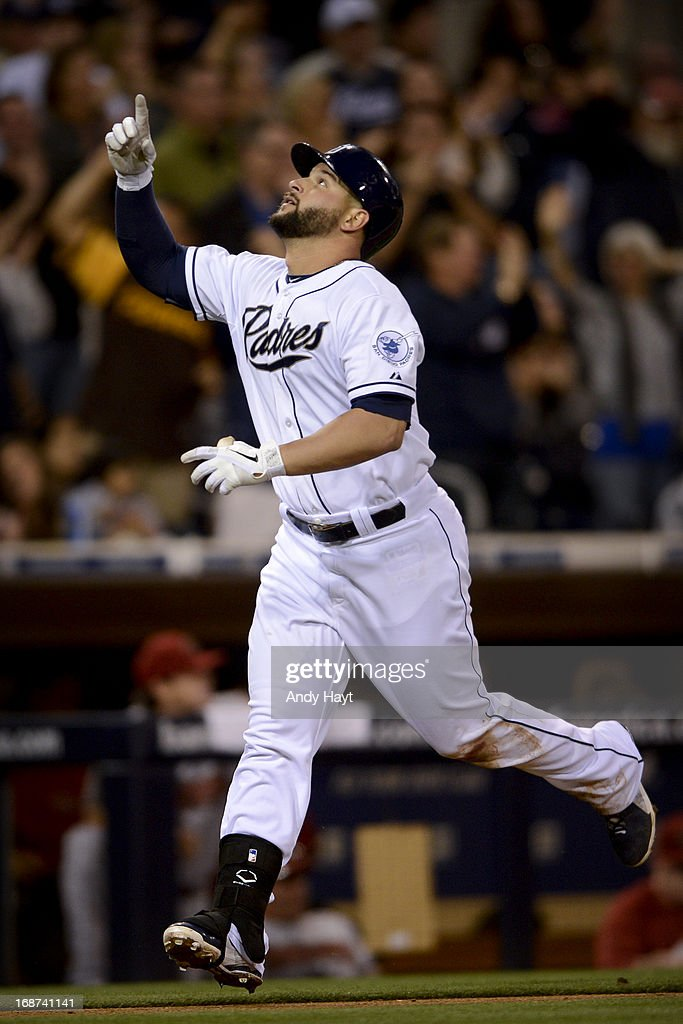 Yonder Alonso of the San Diego Padres celebrates hitting a tworun home run against the Arizona Diamondbacks at Petco Park on May 3 2013 in San Diego...