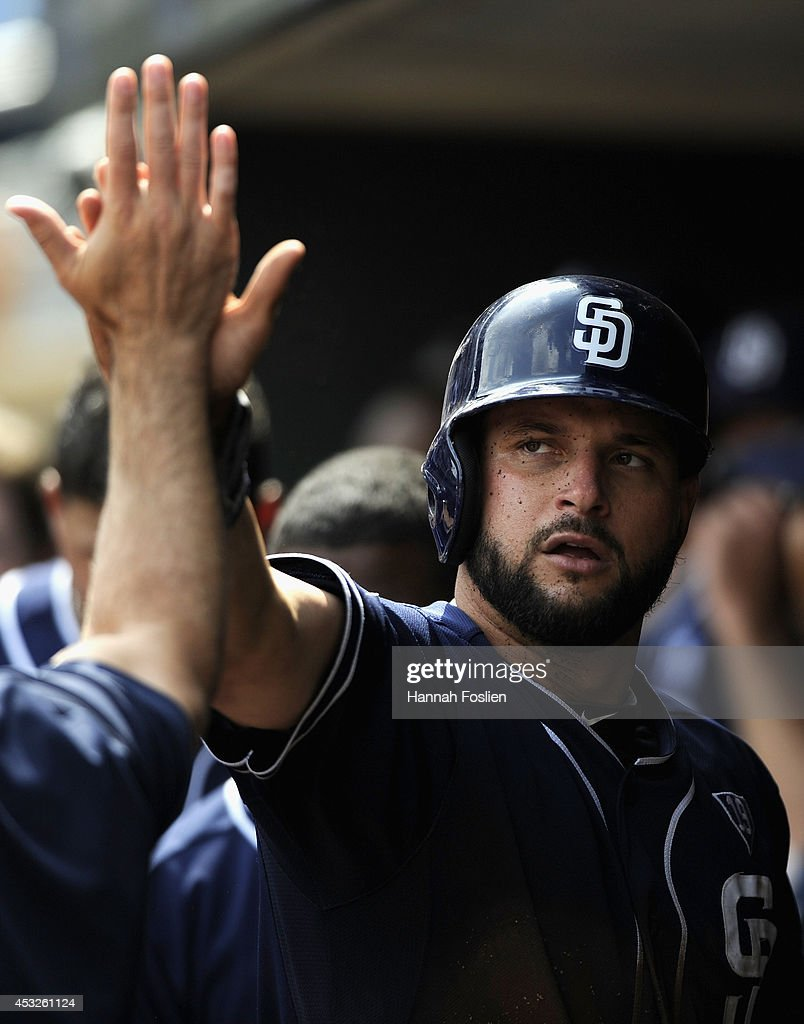 <a gi-track='captionPersonalityLinkClicked' href=/galleries/search?phrase=Yonder+Alonso&family=editorial&specificpeople=4424898 ng-click='$event.stopPropagation()'>Yonder Alonso</a> #23 of the San Diego Padres celebrates scoring a run against the Minnesota Twins during the ninth inning of the game on August 6, 2014 at Target Field in Minneapolis, Minnesota. The Padres defeated the Twins 5-4 in ten innings.