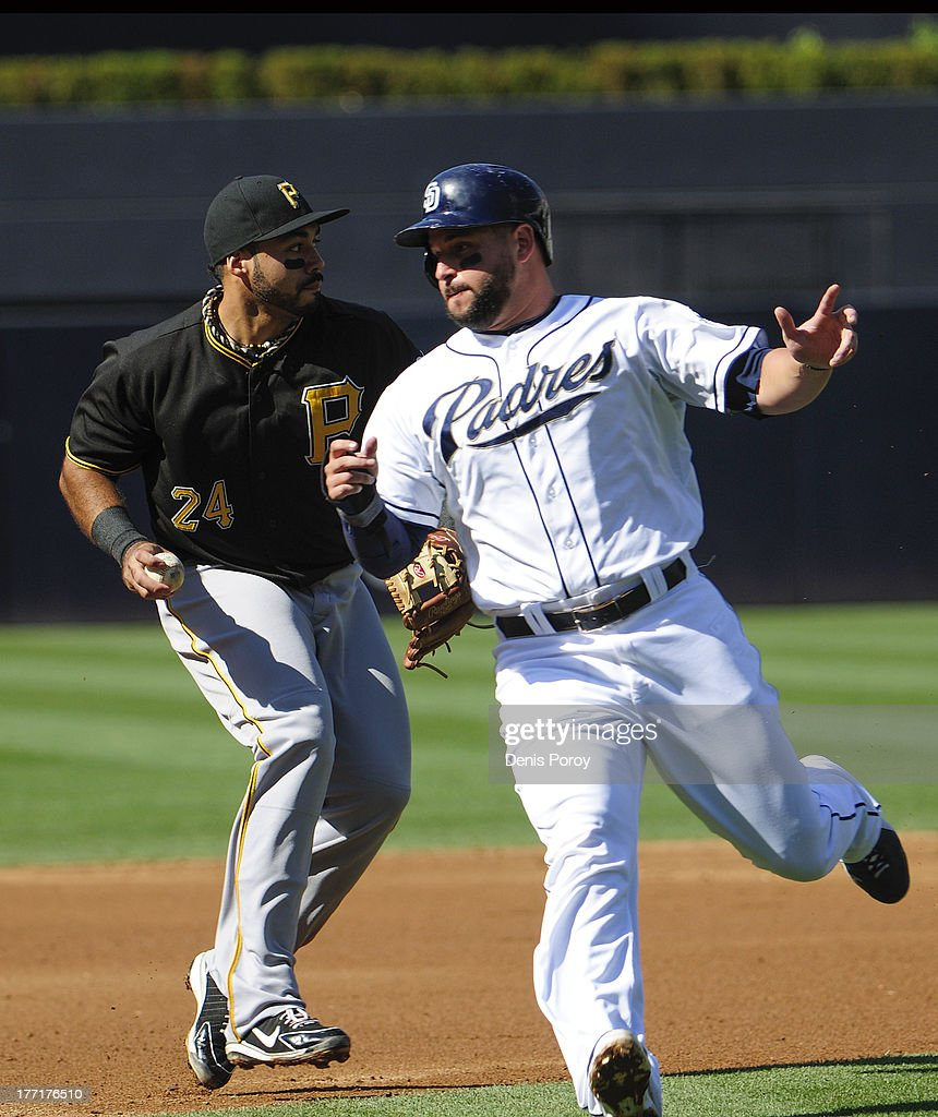 <a gi-track='captionPersonalityLinkClicked' href=/galleries/search?phrase=Yonder+Alonso&family=editorial&specificpeople=4424898 ng-click='$event.stopPropagation()'>Yonder Alonso</a> #23 of the San Diego Padres goes around Pedro Alvarez #24 of the Pittsburgh Pirates as he runs to third base during the second inning of a baseball game at Petco Park on August 21, 2013 in San Diego, California.