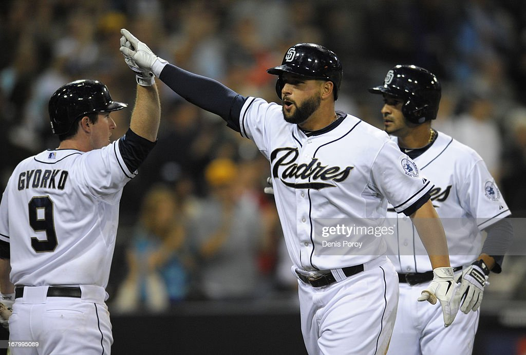 <a gi-track='captionPersonalityLinkClicked' href=/galleries/search?phrase=Yonder+Alonso&family=editorial&specificpeople=4424898 ng-click='$event.stopPropagation()'>Yonder Alonso</a> #23 of the San Diego Padres high-fives <a gi-track='captionPersonalityLinkClicked' href=/galleries/search?phrase=Jedd+Gyorko&family=editorial&specificpeople=8830434 ng-click='$event.stopPropagation()'>Jedd Gyorko</a> #9 after hitting a two-run home run in the fifth inning of a baseball game against the Arizona Diamondbacks at Petco Park on May 3, 2013 in San Diego, California.