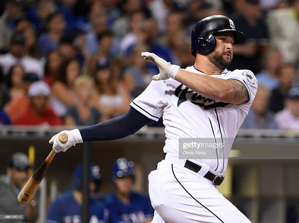 Yonder Alonso of the San Diego Padres hits a double during the third inning of a baseball game against the Texas Rangers at Petco Park August 2015 in...