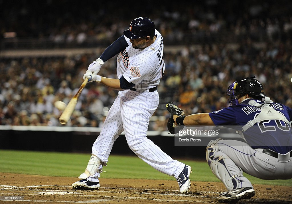 <a gi-track='captionPersonalityLinkClicked' href=/galleries/search?phrase=Yonder+Alonso&family=editorial&specificpeople=4424898 ng-click='$event.stopPropagation()'>Yonder Alonso</a> #23 of the San Diego Padres hits a grand slam as <a gi-track='captionPersonalityLinkClicked' href=/galleries/search?phrase=Wilin+Rosario&family=editorial&specificpeople=5734314 ng-click='$event.stopPropagation()'>Wilin Rosario</a> #20 of the Colorado Rockies catches during the first inning of a baseball game at Petco Park on September 14, 2012 in San Diego, California.