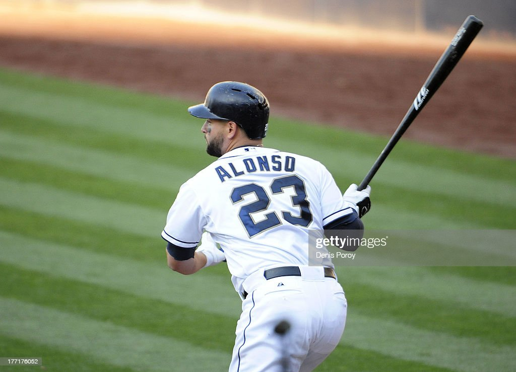 <a gi-track='captionPersonalityLinkClicked' href=/galleries/search?phrase=Yonder+Alonso&family=editorial&specificpeople=4424898 ng-click='$event.stopPropagation()'>Yonder Alonso</a> #23 of the San Diego Padres hits a sacrifice fly ball during the fifth inning of a baseball game against the Pittsburgh Pirates at Petco Park on August 21, 2013 in San Diego, California.