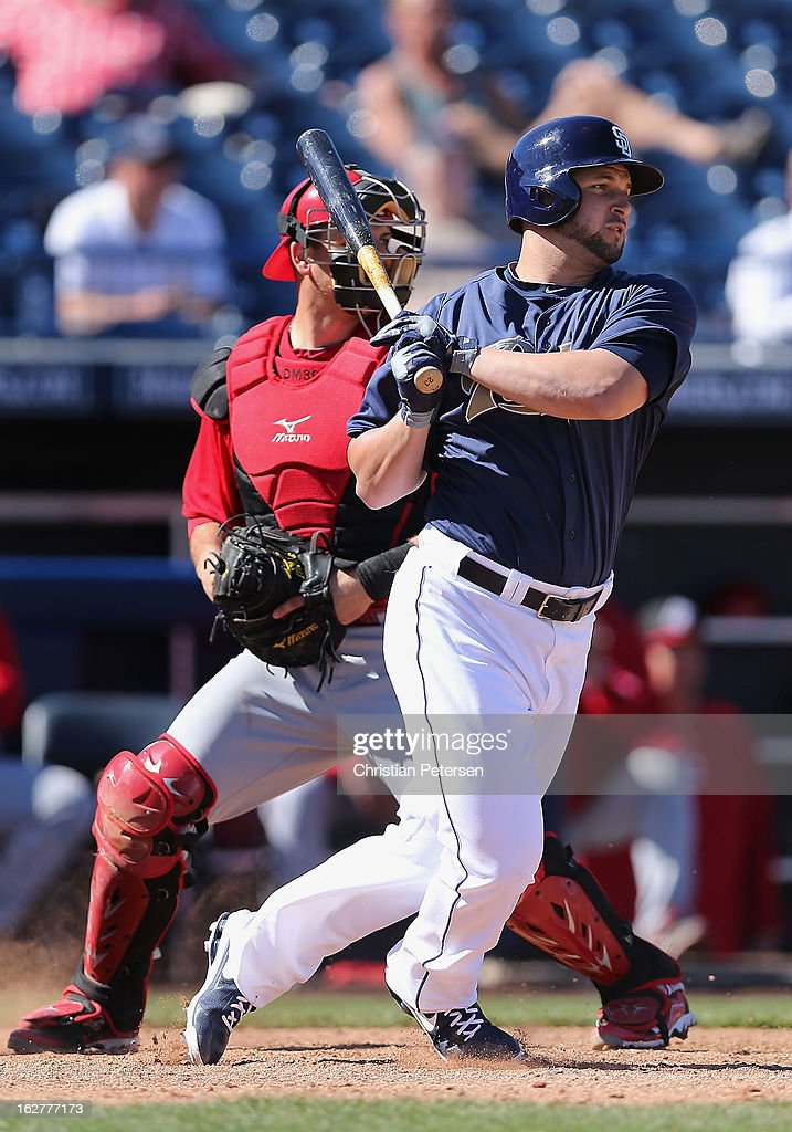<a gi-track='captionPersonalityLinkClicked' href=/galleries/search?phrase=Yonder+Alonso&family=editorial&specificpeople=4424898 ng-click='$event.stopPropagation()'>Yonder Alonso</a> #23 of the San Diego Padres hits a single against the Cincinnati Reds during the fourth inning of the spring training game at Peoria Stadium on February 26, 2013 in Peoria, Arizona.