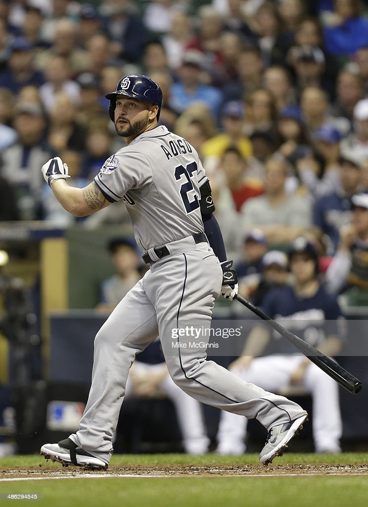 Yonder Alonso of the San Diego Padres hits a single to left field in the top of the second inning against the Milwaukee Brewers during the game at...