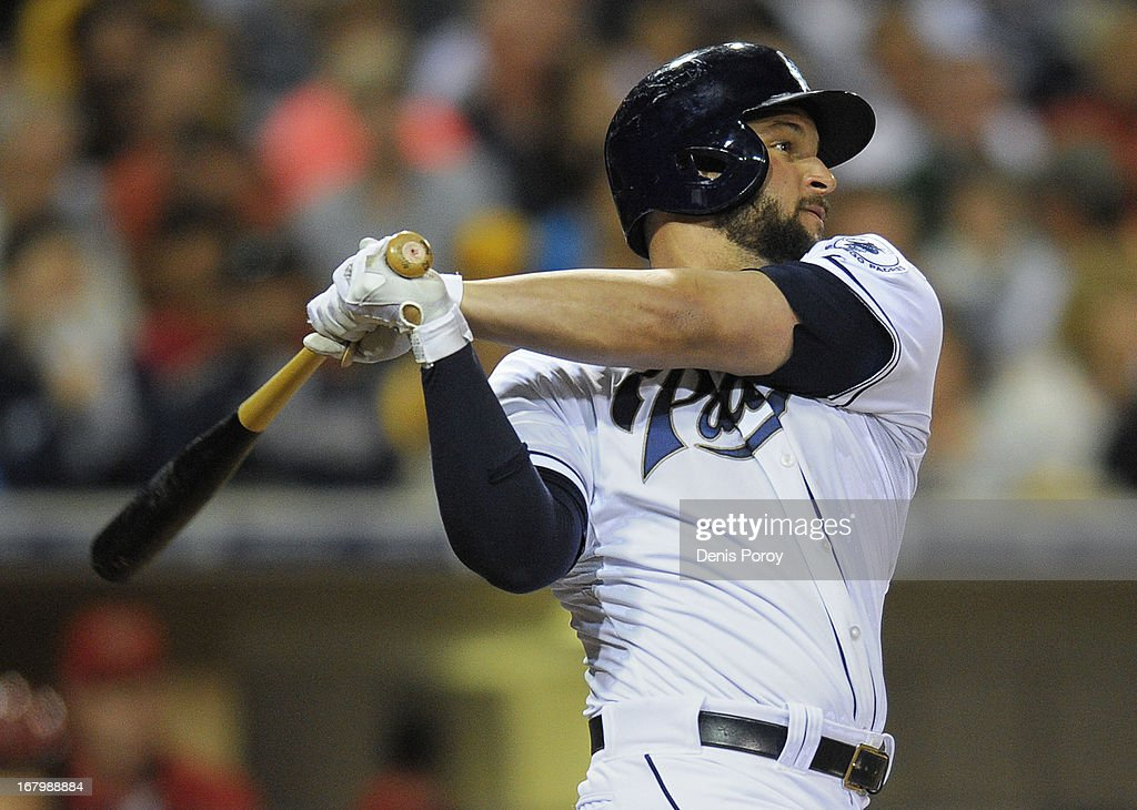 <a gi-track='captionPersonalityLinkClicked' href=/galleries/search?phrase=Yonder+Alonso&family=editorial&specificpeople=4424898 ng-click='$event.stopPropagation()'>Yonder Alonso</a> #23 of the San Diego Padres hits a two-run home run during the fifth inning of a baseball game against the Arizona Diamondbacks at Petco Park on May 3, 2013 in San Diego, California.