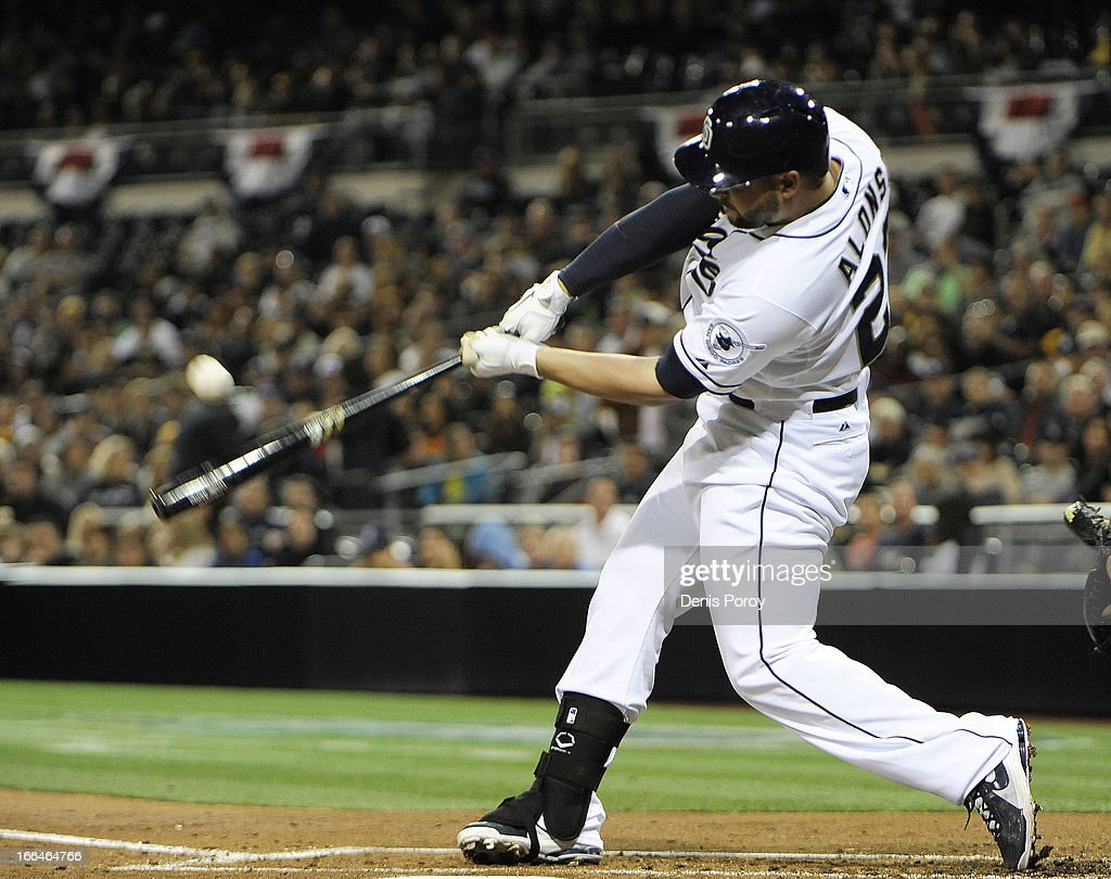 <a gi-track='captionPersonalityLinkClicked' href=/galleries/search?phrase=Yonder+Alonso&family=editorial&specificpeople=4424898 ng-click='$event.stopPropagation()'>Yonder Alonso</a> #23 of the San Diego Padres hits a two-run homer in the first inning against the Colorado Rockies at Petco Park on April 12, 2013 in San Diego, California.