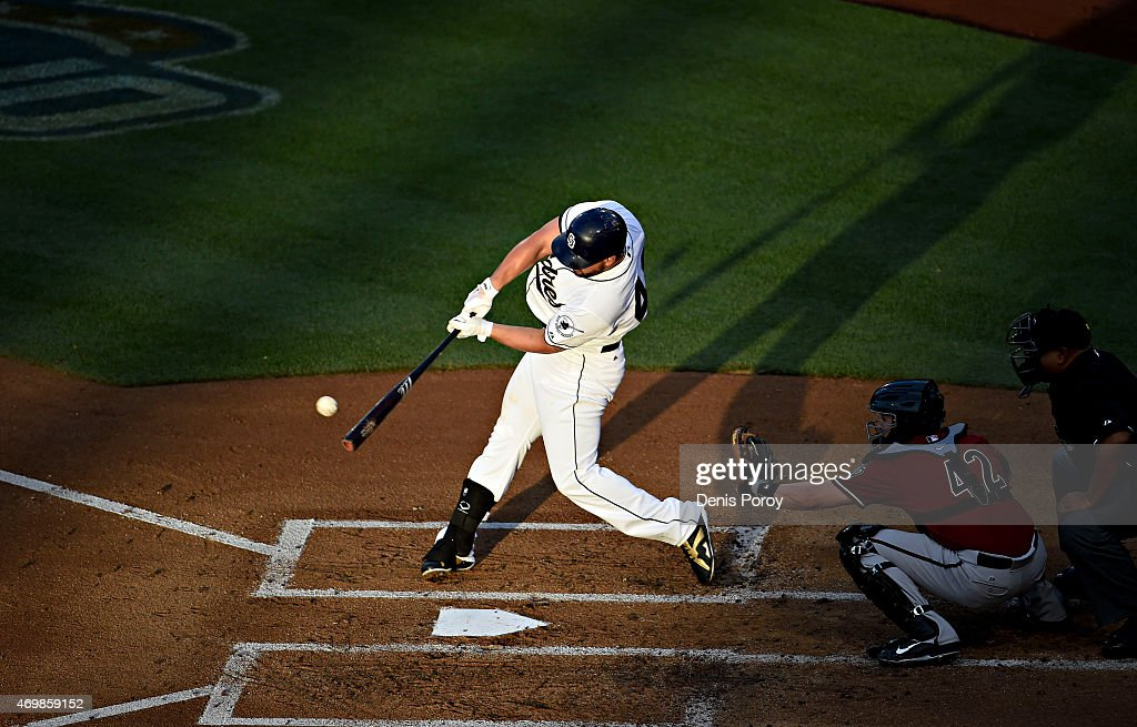 Yonder Alonso of the San Diego Padres hits an RBI double during the second inning of a baseball game against the Arizona Diamondbacks at Petco Park...