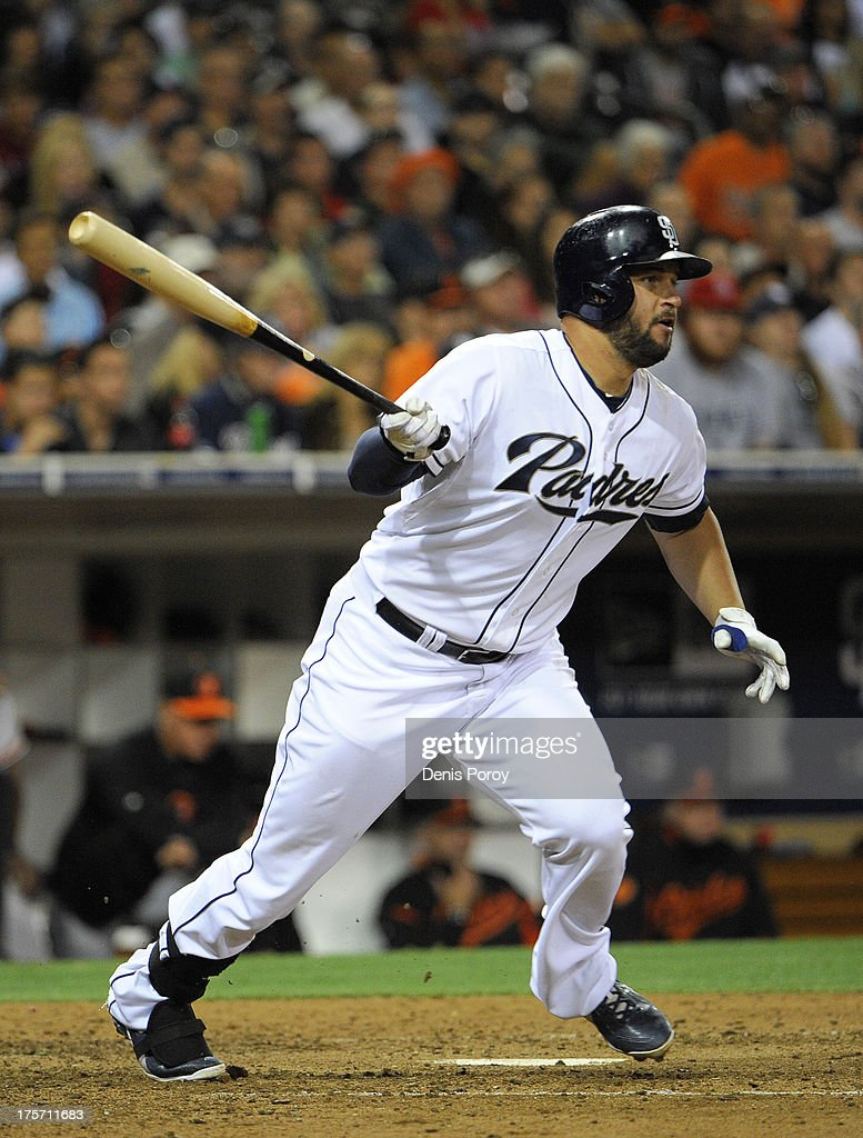 <a gi-track='captionPersonalityLinkClicked' href=/galleries/search?phrase=Yonder+Alonso&family=editorial&specificpeople=4424898 ng-click='$event.stopPropagation()'>Yonder Alonso</a> #23 of the San Diego Padres hits an RBI single during the sixth inning of a baseball game against the Baltimore Orioles at Petco Park on August 6, 2013 in San Diego, California.