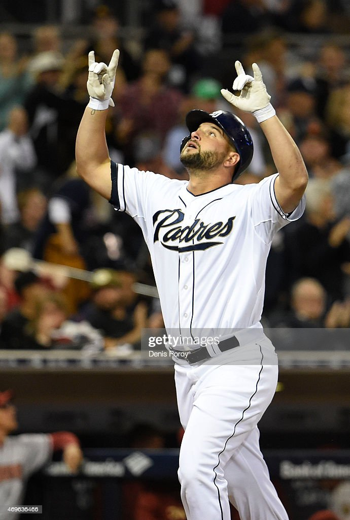 Yonder Alonso of the San Diego Padres looks skyward after hitting a solo home run during the second inning of a baseball game against the Arizona...