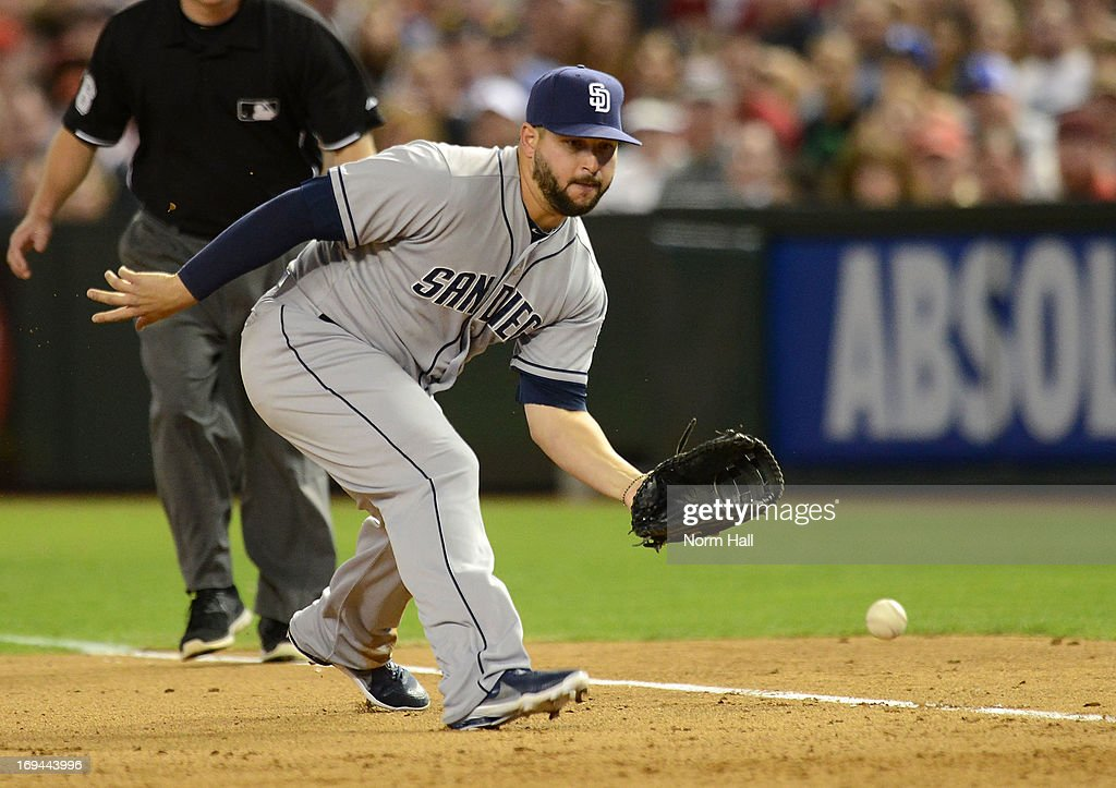 Yonder Alonso #23 of the San Diego Padres makes a play on a ground ball against the Arizona Diamondbacks at Chase Field on May 24, 2013 in Phoenix, Arizona.