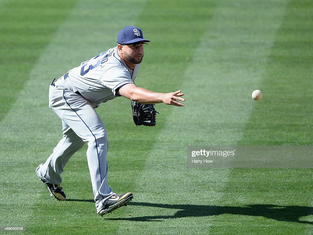 Yonder Alonso of the San Diego Padres makes a play to first on a ground ball during opening day against the Los Angeles Dodgers at Dodger Stadium on...