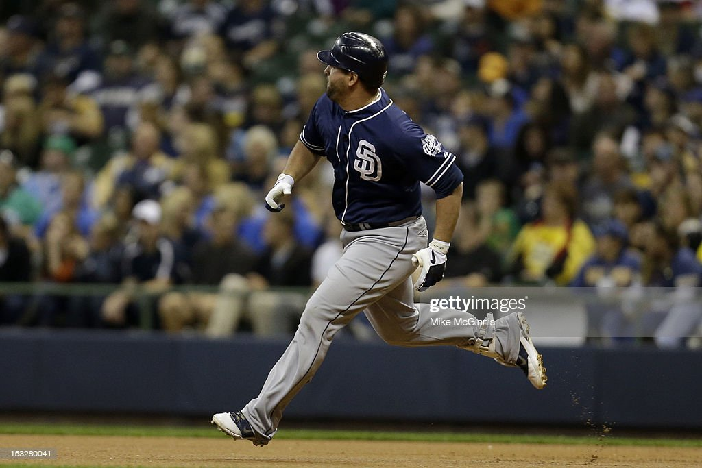 <a gi-track='captionPersonalityLinkClicked' href=/galleries/search?phrase=Yonder+Alonso&family=editorial&specificpeople=4424898 ng-click='$event.stopPropagation()'>Yonder Alonso</a> #23 of the San Diego Padres runs to second base on a double hit in the top of the second inning against the Milwaukee Brewers at Miller Park on October 2, 2012 in Milwaukee, Wisconsin.