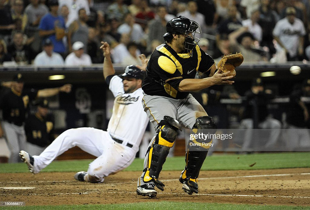 <a gi-track='captionPersonalityLinkClicked' href=/galleries/search?phrase=Yonder+Alonso&family=editorial&specificpeople=4424898 ng-click='$event.stopPropagation()'>Yonder Alonso</a> #23 of the San Diego Padres scores as <a gi-track='captionPersonalityLinkClicked' href=/galleries/search?phrase=Rod+Barajas&family=editorial&specificpeople=211198 ng-click='$event.stopPropagation()'>Rod Barajas</a> #26 of the Pittsburgh Pirates fields the throw during the seventh inning of a baseball game at Petco Park on August 21, 2012 in San Diego, California.