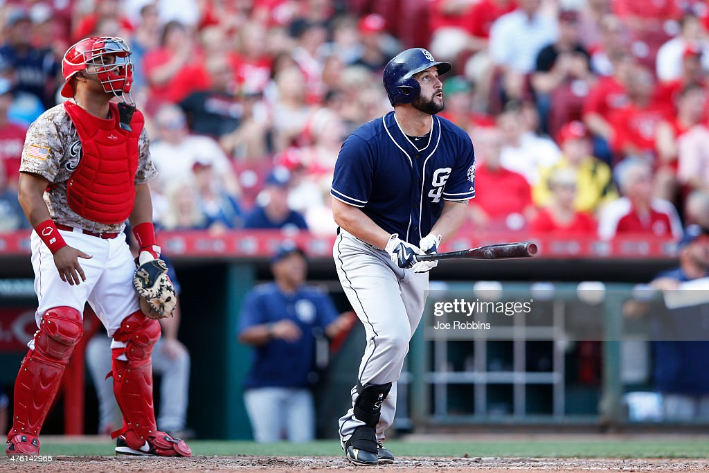 Yonder Alonso of the San Diego Padres watches his grand slam home run which tied the game in the seventh inning against the Cincinnati Reds at Great...