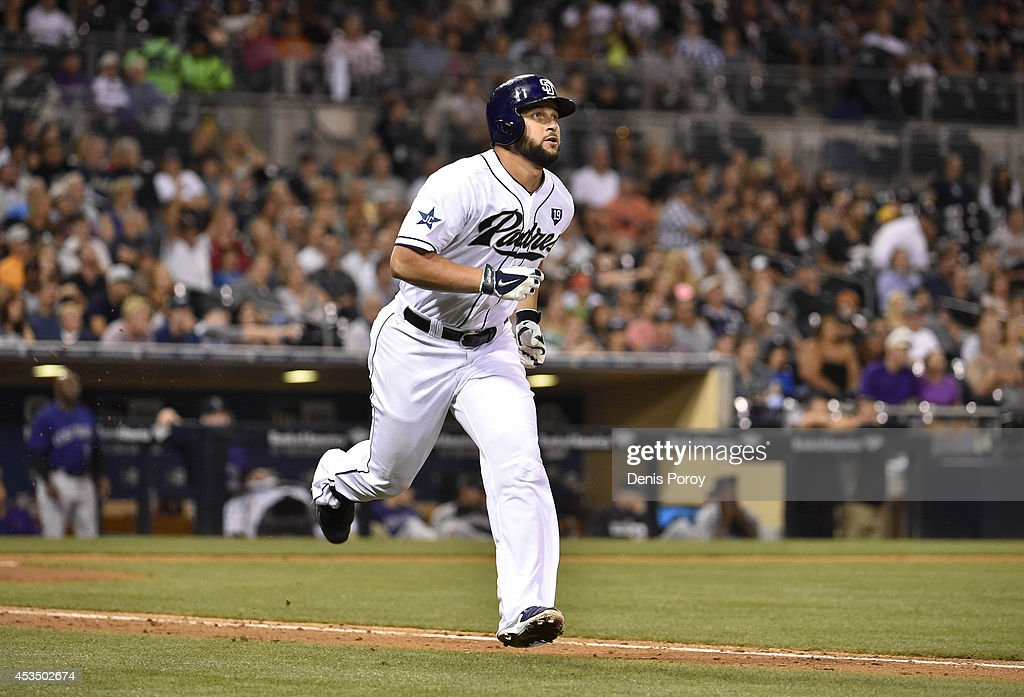Yonder Alonso of the San Diego Padres watches the flight of his solo home run hit during the fourth inning of a baseball game against the Colorado...