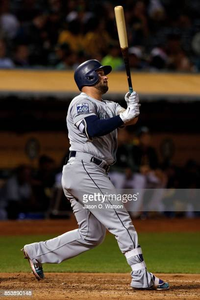 Yonder Alonso of the Seattle Mariners hits a home run against the Oakland Athletics during the fourth inning at the Oakland Coliseum on September 25...