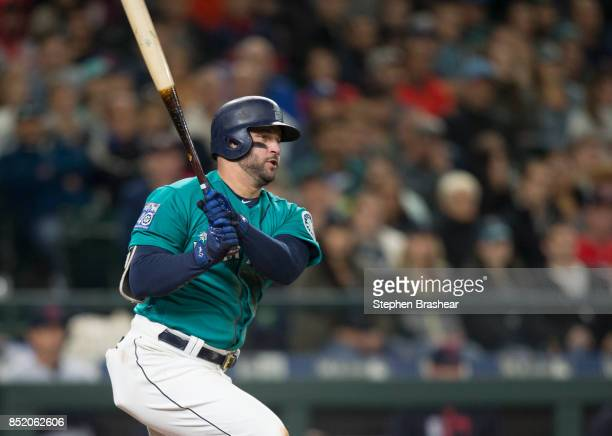 Yonder Alonso of the Seattle Mariners hits a RBIsingle off of starting pitcher Trevor Bauer of the Cleveland Indians that scored Kyle Seager of the...